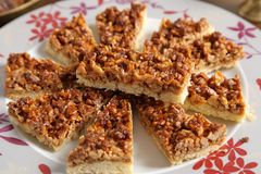 Cake with caramelized walnuts. Royalty Free Stock Photo