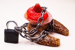 Cake with chain and padlock, diet concept. Royalty Free Stock Photo