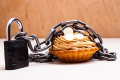 Cake with chain and padlock, diet concept. Royalty Free Stock Photography