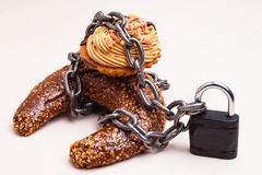 Cake with chain and padlock, diet concept. Royalty Free Stock Image