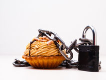 Cake with chain and padlock, diet concept. Stock Photography