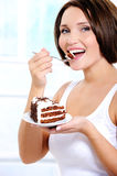 cake cheerful eats sweet woman young Στοκ Φωτογραφίες