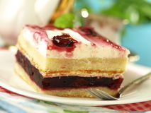 Cake with cherries and cream Royalty Free Stock Photos