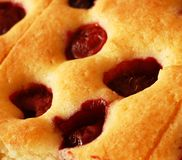 Cake with cherries and raspberries Stock Images