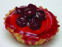 Cake with cherry Royalty Free Stock Image