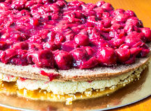 Cake with cherry. Close-up photo of fancy cake with cherry Royalty Free Stock Photos