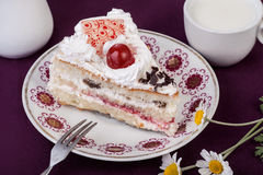 Cake with cherry with cup of milk Stock Photo