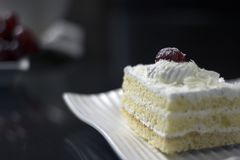Cherry on top of cake stock photography