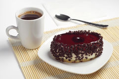Cake with cherry jelly and coffee Royalty Free Stock Images