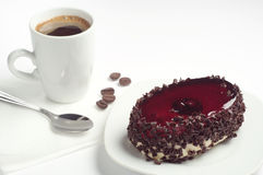Cake with cherry jelly and coffee Stock Photos