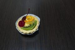 Cake cherry orange kiwi Royalty Free Stock Images