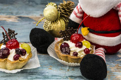 Cake with cherry and Santa Claus Royalty Free Stock Photos