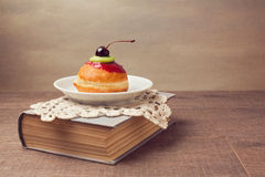Cake with cherry on top. Artistic retro vintage style Royalty Free Stock Photography