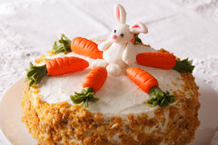 Cake for children, decorated with carrot and bunny close-up Royalty Free Stock Photos