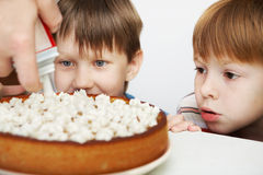 Cake and children Stock Photos