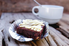 Cake chocolate brownie and hot coffee on old wooden background. Royalty Free Stock Photos