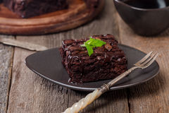 Cake chocolate brownies with dark chocolate  dressing and mint Royalty Free Stock Photos
