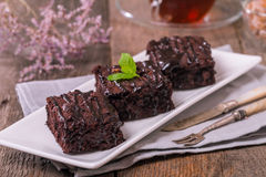 Cake chocolate brownies with dark chocolate  dressing and mint Royalty Free Stock Image