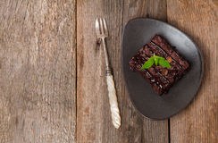 Cake chocolate brownies with dark chocolate  dressing and mint Stock Image