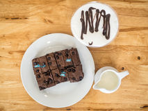 Cake chocolate brownies with fresh milk Royalty Free Stock Photo