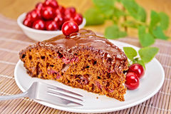 Cake chocolate with cherries on bamboo napkin Stock Photo