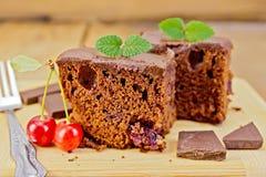 Cake chocolate with cherries on board Stock Photo