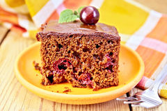 Cake chocolate with cherries and napkin on board Royalty Free Stock Photo