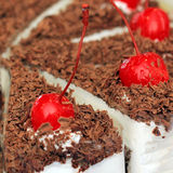 Cake with chocolate and cherry on top Royalty Free Stock Photography