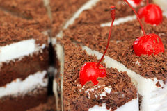 Cake with chocolate and cherry on top Stock Images