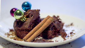 Cake. Chocolate cake with cinnamon stick Royalty Free Stock Photos