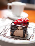 Cake with chocolate cream and berries Royalty Free Stock Photos