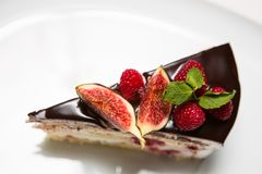 Cake with chocolate, fig and raspberry Royalty Free Stock Images