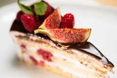 Cake with chocolate, fig and raspberry Stock Images
