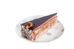 Cake with chocolate frosting, walnuts and caramel Royalty Free Stock Image