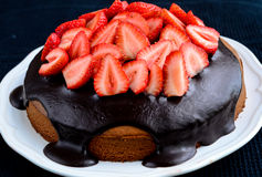 Cake. Chocolate cake with ganache and strawberries Stock Image