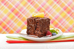 Cake with a chocolate gloss on plate Royalty Free Stock Photography