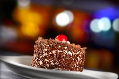 Cake. Chocolate cake having red cherry on top of it Stock Photo