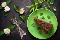Cake with chocolate, honey and mint. Black background. Top view. Close-up Royalty Free Stock Images