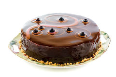 Cake with chocolate icing. Royalty Free Stock Image