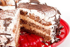 Cake chocolate on red plate Royalty Free Stock Images