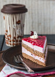 Cake with chocolate sponge cake, berry mousse and cherry jelly Stock Photography