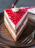 Cake with chocolate sponge cake, berry mousse and cherry jelly Stock Images