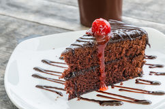 Cake. Chocolate cake in white dish on the wood table Stock Photography