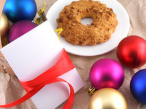 Cake, christmas balls and white invitation card Royalty Free Stock Photos