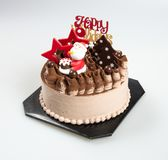 Cake or christmas cakes with santa on a background. Cake or christmas cakes with santa on a background Royalty Free Stock Photos