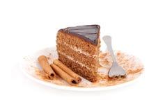 Cake and cinnamon. Slice of chocolate cream cake with cinnamon Stock Photo