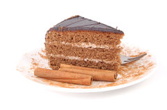 Cake and cinnamon Stock Images