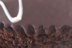 Cake in close up. Macro close-up of chocolate cake showing sponge and icing Stock Photo