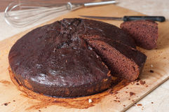 Cake of the cocoa. Polish honey cake of the cocoa about the name of deeply tanned man in the kitchen Royalty Free Stock Photos