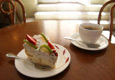 Cake and coffee. Cup of coffee and a piece of cake on the table royalty free stock photos